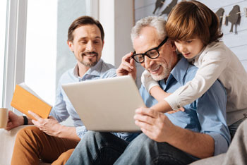 three generations looking at computer